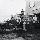 A photo shows a McDonalds Cromwell Transport truck loading fruit cases ...