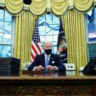 US President Joe Biden signs executive orders in the Oval Office of the White House yesterday....