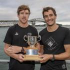 New Zealand Olympic sailors Peter Burling (left) and Blair Tuke pose with the Lonsdale Cup at the...