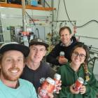 Loose Moose Canning Co owner Wesley McAllister, left, with employees Matthew Ward, Charlotte Hind...