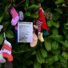Some of the victims names hang from a tree at a graveyard where the bodies of 796 babies were...