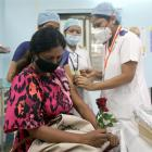 A healthcare worker receives a Covid vaccine shot at a medical centre in Mumbai. Photo: Reuters
