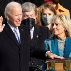 Joe Biden is sworn in as the 46th president of the United States as Jill Biden holds the Bible...