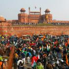 Farmers gather in front of the historic Red Fort during a protest against farm laws introduced by...