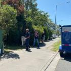 Police at the Papanui property after the body was found. Photo: Anna Leask / NZH