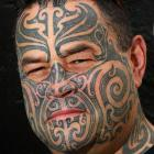 Jamie Addison shows his full-face moko, which represents his Maori culture and the journey he...
