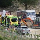 Emergency services and other people work at the scene of a fatal tractor accident yesterday....