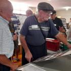 Bill Robinson, left, and Kevin Prue checking out historical photographs of the days at Burnetts...