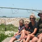 Dairy farmers Ali Van Polanen and Andrew Black with their children Florence and Hudson are happy...