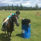 Alyssa Goble (9), of Tapanui, picks up a toy gorilla in one of the many unorthodox exercises in...