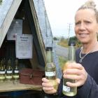 Jo Heslop, of Manuka Gorge, restocks her quirky roadside stall with elderflower cordial after 11...