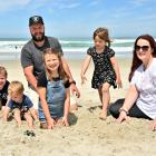 Parents Owen Lodge and Kimberly Wallace, along with their children (from left) Grayson Lodge (3),...