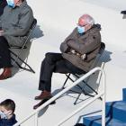 U.S. Senator Bernie Sanders sit socially distanced as he attends the Presidential Inauguration of...