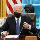 US President Joe Biden signs an executive order repealing former President Trump's ban on...