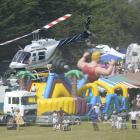 A HeliOtago helicopter lifts off from the Brighton Domain for a scenic flight at the Brighton...