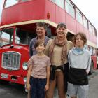 Victoria and Paul Ludemann and their children Linzi and Chase with their double-decker bus,...