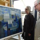 RDS Gallery director Hilary Radner and Alistair Fox, both of Dunedin, admire the winning painting...