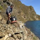 Jake Schofield, of Timaru, uses a rock crusher on the Cromwell Gorge cycle trail.