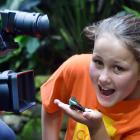 Code Fun television show ''little critter'' co-presenter Maisie Devlin holds a tropical butterfly...