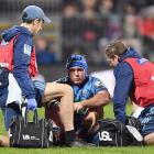 James Parsons receives medical help during the Blues v Crusaders game in Christchurch last year....