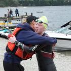 Meg McLaughlan gets a hug from her mother Jo at the end of her epic swim. Photo: Mark Price