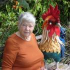 Gill Shaw relaxes next to a rooster she created by felting and dying the fibre before use. PHOTOS...