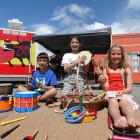 Antony (9) and Annabell (10) Keith, and Nevaeh McLintock (7) help out the buskers at Kurow's...
