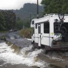 A campervan crosses the Silverstream ford after leaving the Whare Flat Folk Festival at the...