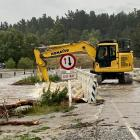 Patearoa township bridge was being cleared of debris this morning after flooding in the Maniototo...