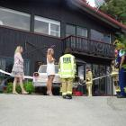 Police and fire crew speak to people at the scene of a minor crash in Queenstown. Photo: Matthew...