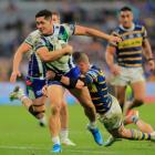 Roger Tuivasa-Sheck prepares to let go of the offload which was ruled forward to deny the...