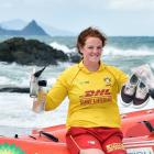 Brighton Surf Life Saving Club member Phoebe Aburn (19) shows some of the rubbish left on...
