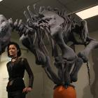 He Waka Tuia Art + Museum exhibition host Emma Coppin poses with her favourite art from Michele...