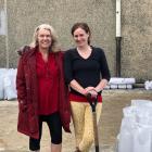 Taieri MP Ingrid Leary (left) and Volunteer South manager Leisa de Klerk help fill sandbags at...