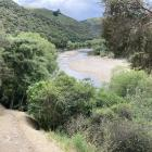 The track runs alongside the Taieri River.