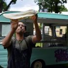 Slice of Heaven owner Gareth West throws pizza dough in the air on the Otago Museum lawn in North...