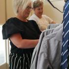 Otago Boys' High School Parent Teacher Association uniform co-ordinator Stephanie Mason (left)...
