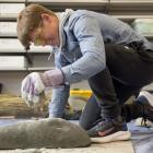 Waitara High School pupil Joseph Hill, of Taranaki, makes a stone tool at the University of Otago...