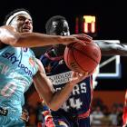 Tai Webster takes the ball to the hoop for the Breakers as Sunday Dech guards him in Adelaide...
