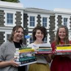 University Book Shop staff members (from left) Rosie Hill, Charlotte McKay and Rebekah Clements...