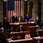 US Vice President Mike Pence speaks as U.S. House Speaker Nancy Pelosi listens during a joint...