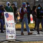 A sign is seen as voters line up for the US Senate run-off election, at a polling location in...