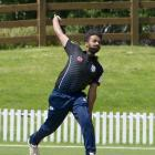 Vinay Chandrappa steams in for Carisbrook-Dunedin Kaikorai at the University Oval club cricket...