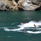 Jet-skiers play on Lake Dunstan recently. PHOTO: STEPHEN JAQUIERY
