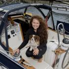 American solo circumnavigator Elana Connor and rescue dog Zia, aboard her yacht Windfola, which...
