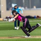 New Zealand XI batswoman Natalie Dodd clips the ball legside during a tour game against England...