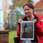 Sally Flavill shows a photograph of her nephew Joseph Flavill, who has awoken from a coma with no...