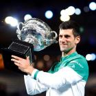 Novak Djokovic celebrates with the trophy after his victory in the Australian Open final. Photo:...