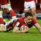 Wales' Kieran Hardy scores their third try. Photo: Reuters