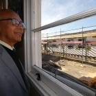 Maniototo Area School principal Joe Ferdinands watches from one of the school buildings as the...